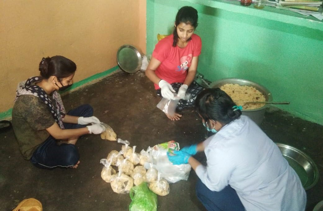 Lotus teacher volunteers preparing hot food for slum dwellers